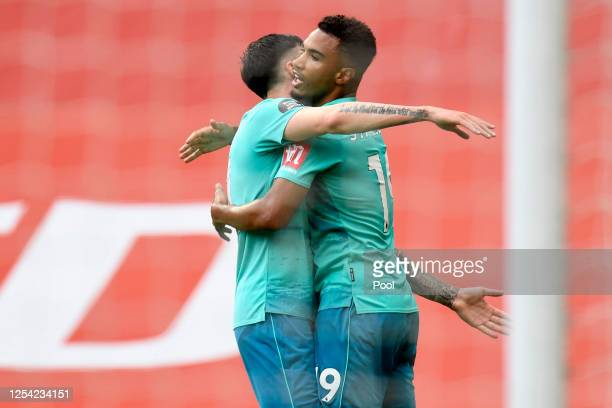 Junior Stanislas of AFC Bournemouth celebrates with teammate after scoring his team's first goal during the Premier League match between Manchester...