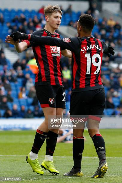Junior Stanislas of AFC Bournemouth celebrates with teammate David Brooks after scoring his team's fifth goal during the Premier League match between...
