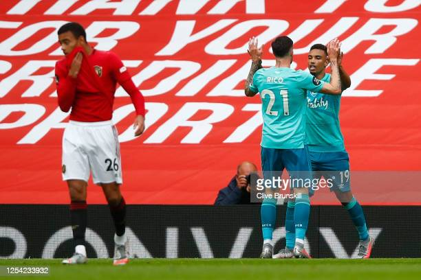 Junior Stanislas of AFC Bournemouth celebrates with teammate Diego Rico of AFC Bournemouth after scoring their sides first goal during the Premier...