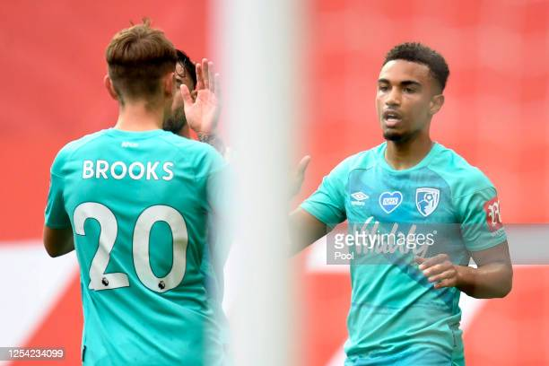 Junior Stanislas of AFC Bournemouth celebrates with teammates after scoring his team's first goal during the Premier League match between Manchester...