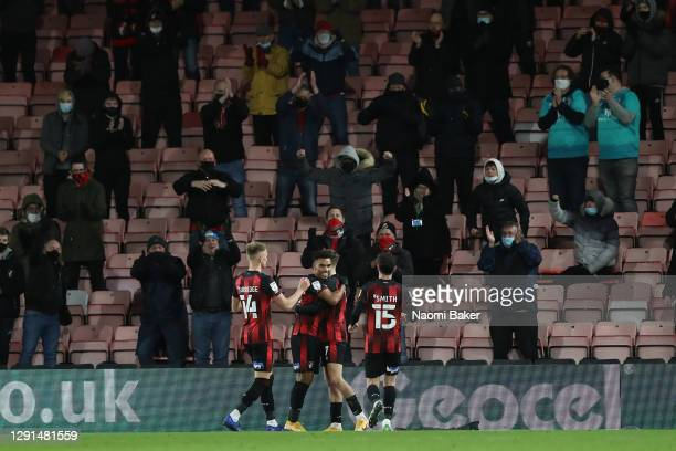 Junior Stanislas of AFC Bournemouth celebrates with teammates after scoring their team's first goal during the Sky Bet Championship match between AFC...