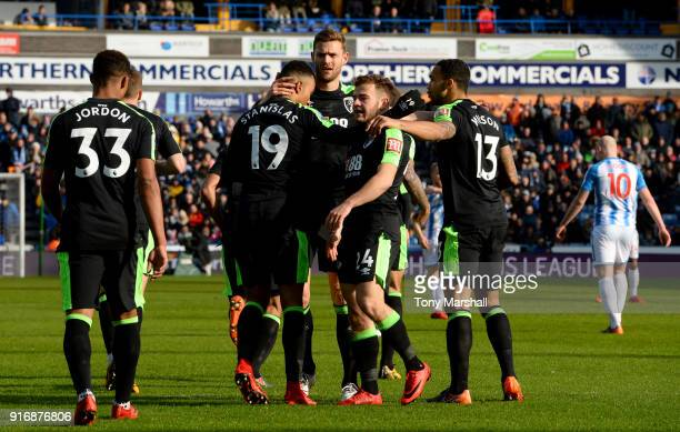 Junior Stanislas of AFC Bournemouth celebrates with teammates after scoring his sides first goal during the Premier League match between Huddersfield...