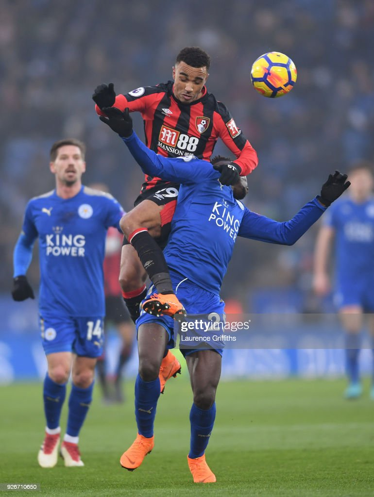 Junior Stanislas of AFC Bournemouth competes for a header with Wilfred Ndidi of Leicester City during the Premier League match between Leicester City and AFC Bournemouth at The King Power Stadium on March 3, 2018 in Leicester, England.