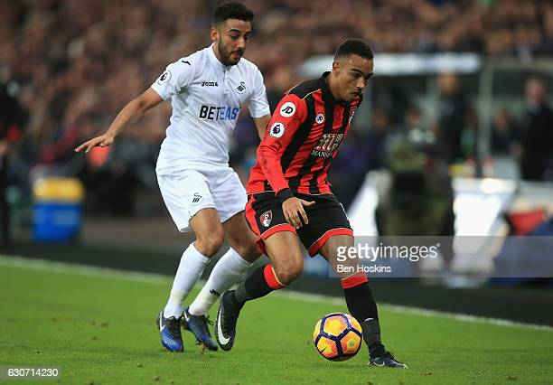 Junior Stanislas of AFC Bournemouth controls the ball under pressure of Neil Taylor of Swansea City during the Premier League match between Swansea...