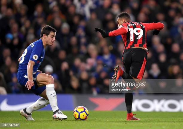 Junior Stanislas of AFC Bournemouth has a back heeled shot under pressure from Cesar Azpilicueta of Chelsea during the Premier League match between...