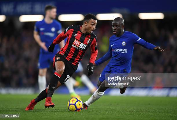 Junior Stanislas of AFC Bournemouth is challenged by N'Golo Kante of Chelsea during the Premier League match between Chelsea and AFC Bournemouth at...