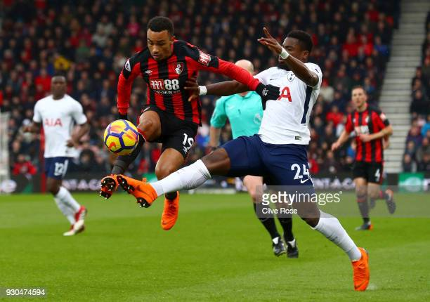 Junior Stanislas of AFC Bournemouth is challenged by Serge Aurier of Tottenham Hotspur during the Premier League match between AFC Bournemouth and...