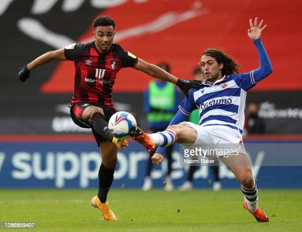 Junior Stanislas of AFC Bournemouth is challenged by Tomas Pontes Esteves of Reading FC during the Sky Bet Championship match between AFC Bournemouth...