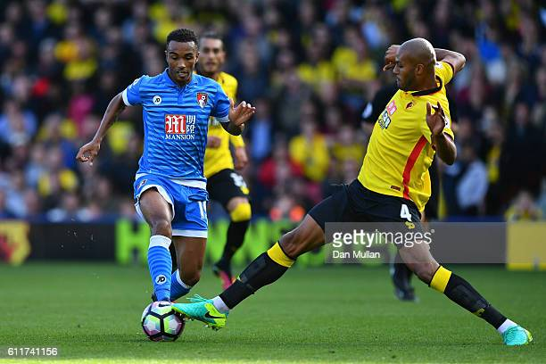 Junior Stanislas of AFC Bournemouth is challenged by Younes Kaboul of Watford during the Premier League match between Watford and AFC Bournemouth at...