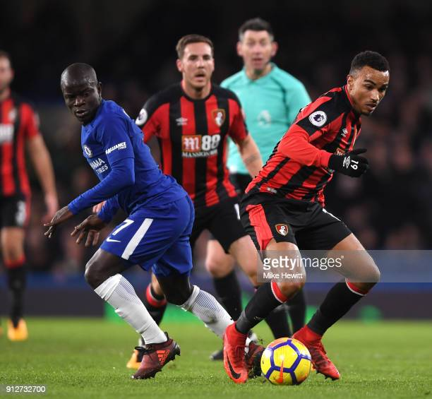 Junior Stanislas of AFC Bournemouth runs with the ball away from the pressure of N'Golo Kante of Chelsea during the Premier League match between...