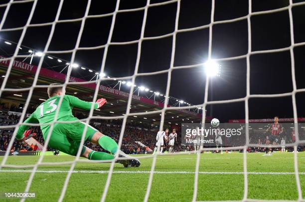 Junior Stanislas of AFC Bournemouth scores his sides second goal from the penalty spot pas Wayne Hennessey of Crystal Palace after his team is...