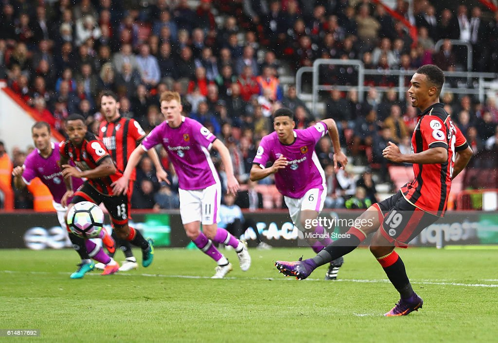 Junior Stanislas of AFC Bournemouth scores his sides third goal from the penalty spot during the Premier League match between AFC Bournemouth and Hull City at Vitality Stadium on October 15, 2016 in Bournemouth, England.