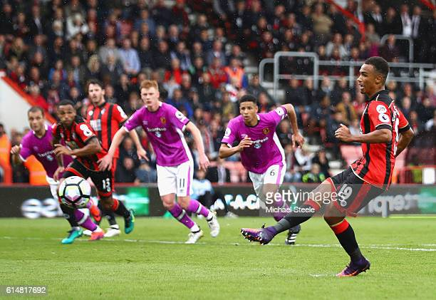 Junior Stanislas of AFC Bournemouth scores his sides third goal from the penalty spot during the Premier League match between AFC Bournemouth and...