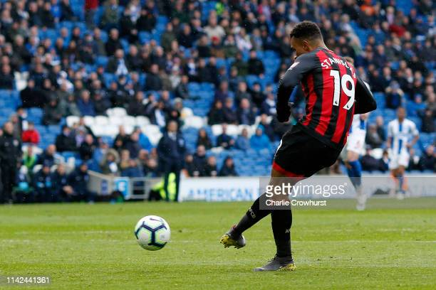 Junior Stanislas of AFC Bournemouth scores his team's fifth goal during the Premier League match between Brighton Hove Albion and AFC Bournemouth at...