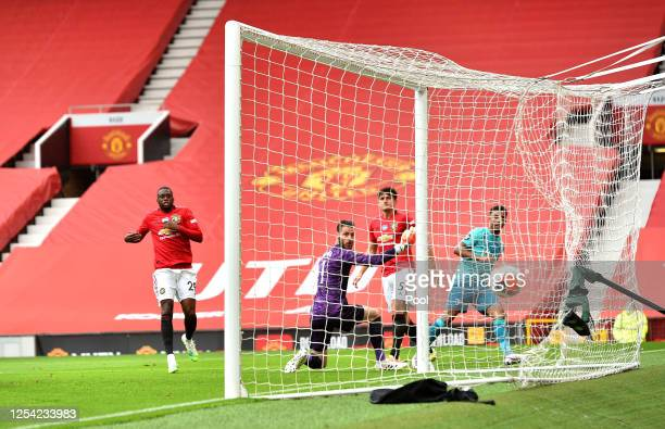 Junior Stanislas of AFC Bournemouth scores his team's first goal past David De Gea of Manchester United during the Premier League match between...