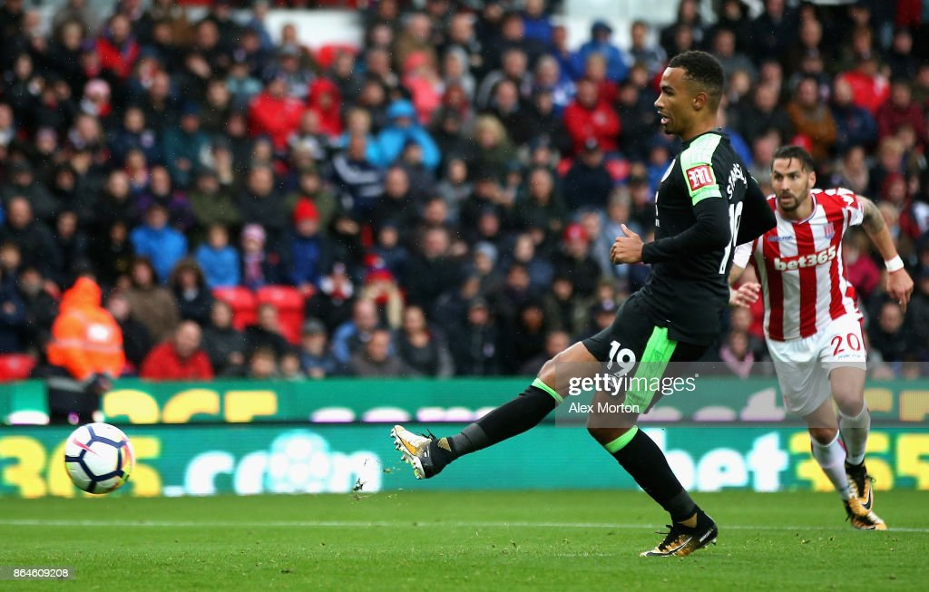 Junior Stanislas of AFC Bournemouth scores the 2nd Bournemouth goal during the Premier League match between Stoke City and AFC Bournemouth at Bet365 Stadium on October 21, 2017 in Stoke on Trent, England.