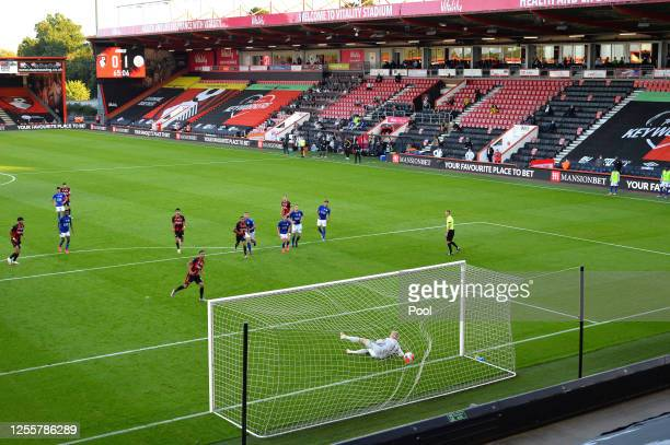 Junior Stanislas of AFC Bournemouth scores their sides first goal from the penalty spot during the Premier League match between AFC Bournemouth and...
