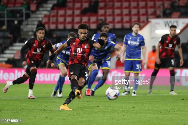 Junior Stanislas of AFC Bournemouth scores their team's second goal from a penalty during the Sky Bet Championship match between AFC Bournemouth and...