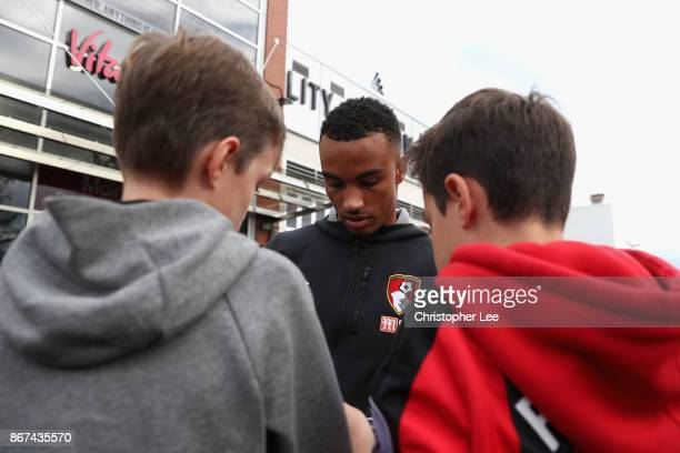 Junior Stanislas of AFC Bournemouth signs autographs for fans prior to the Premier League match between AFC Bournemouth and Chelsea at Vitality...