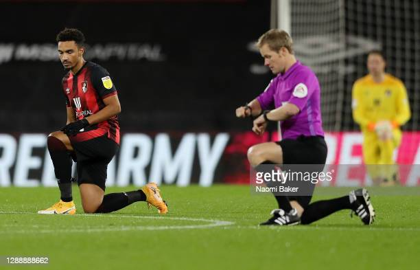 Junior Stanislas of AFC Bournemouth takes a knee in support of the black lives matter movement prior to the Sky Bet Championship match between AFC...