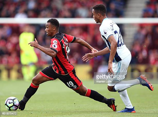 Junior Stanislas of AFC Bournemouth takes the ball past Brendan Galloway of West Bromwich Albion during the Premier League match between AFC...