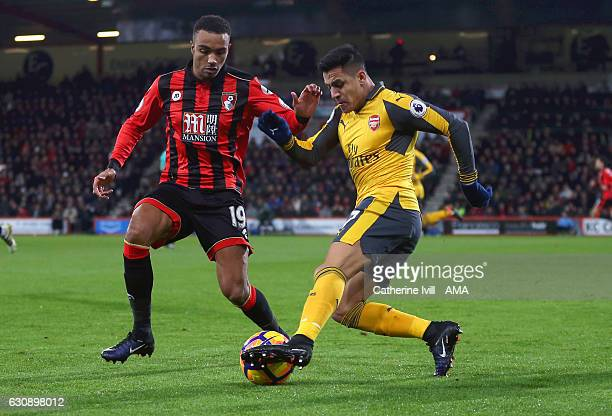 Junior Stanislas of Bournemouth and Alexis Sanchez of Arsenal during the Premier League match between AFC Bournemouth and Arsenal at Vitality Stadium...