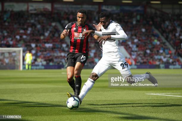 Junior Stanislas of Bournemouth and AndreFrank Zambo Anguissa of Fulham during the Premier League match between AFC Bournemouth and Fulham FC at...