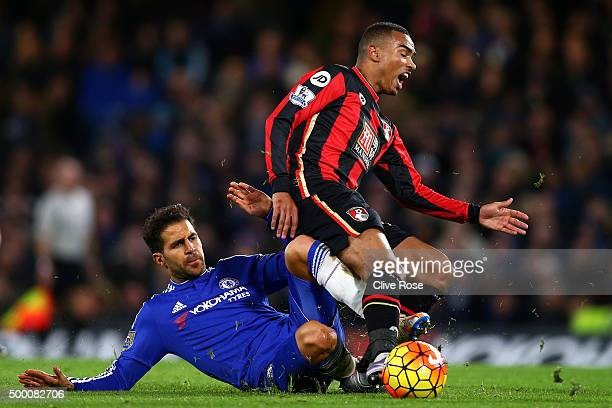 Junior Stanislas of Bournemouth is tackled by Cesc Fabregas of Chelsea during the Barclays Premier League match between Chelsea and AFC Bournemouth...