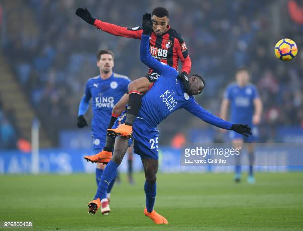 Junior Stanislas of Bournemouth rises for a header with Wilfred Ndidi of Leicester City during the Premier League match between Leicester City and...