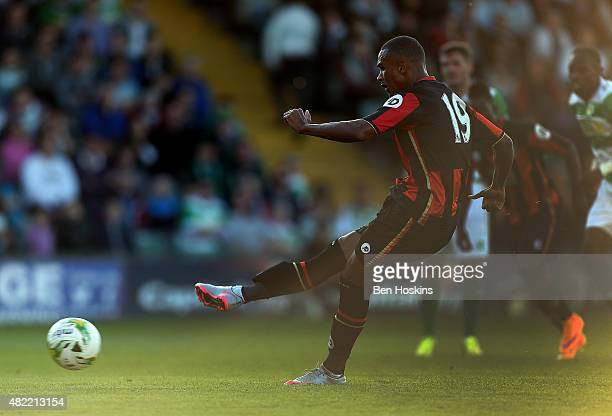 Junior Stanislas of Bournemouth scores from the penalty spot during a Pre Season Friendly between Yeovil Town and AFC Bournemouth at Huish Park on...