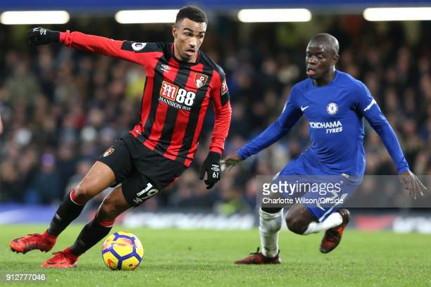 Junior Stanislas of Bournemouth turns to take the ball past NGolo Kante of Chelsea during the Premier League match between Chelsea and AFC...