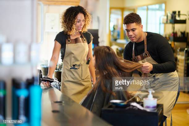 junior stylist with customer and mentor - person in education stock pictures, royalty-free photos & images