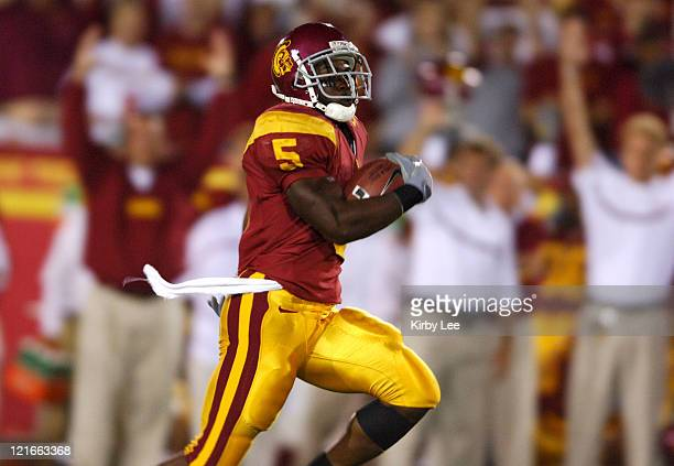 Junior tailback Reggie Bush scores on a 76-yard run in the first quarter of 70-17 victory over Arkansas at the Los Angeles Memorial Coliseum on...