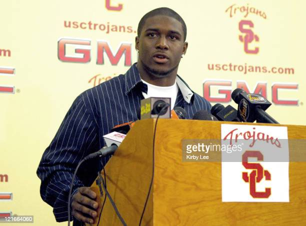 Junior tailback Reggie Bush, the 2005 Heisman Trophy winner, announces his decision to make himself eligible for the NFL draft at press conference at...