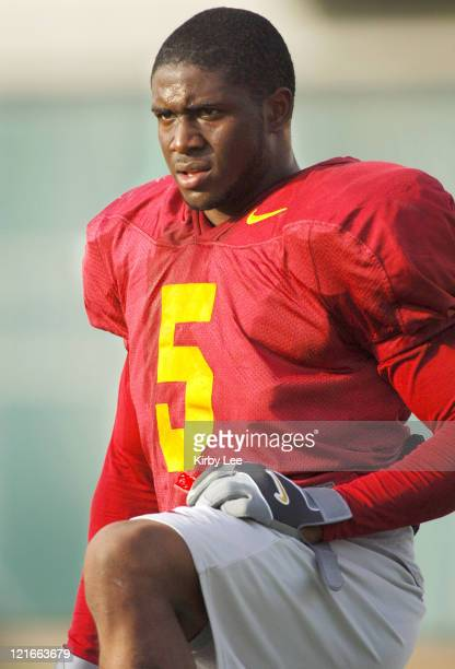 Junior tailback Reggie Bush, the 2005 Heisman Trophy winner, watches practice at Howard Jones Fields on the campus of the University of Southern...