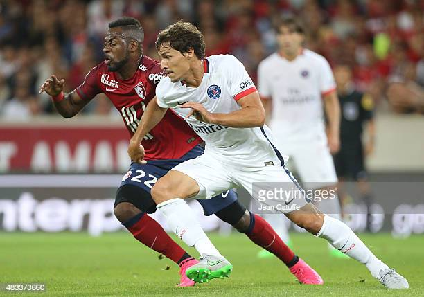 Junior Tallo of Lille and Benjamin Stambouli of PSG in action during the French Ligue 1 match between Lille OSC and Paris SaintGermain at Grand Stade...