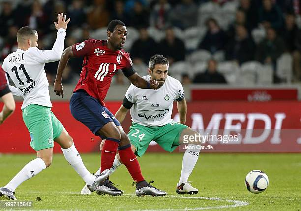 Junior Tallo of Lille and Loic Perrin of SaintEtienne in action during the French Ligue 1 match between Lille OSC and AS SaintEtienne at Stade Pierre...