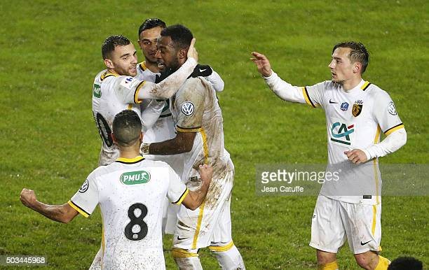 Junior Tallo of Lille celebrates scoring the winning goal with teammates Marvin Martin and Eric Bautheac during the French Cup match between Amiens...