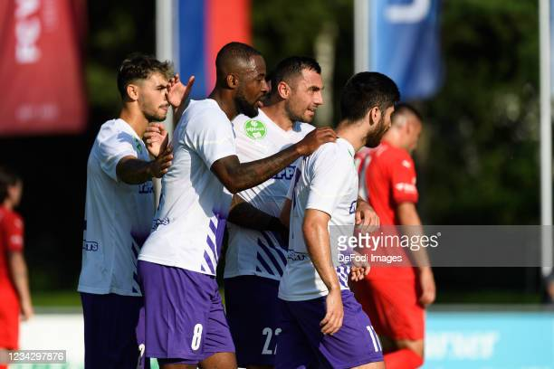 Junior Tallo of Ujpest FC celebrates after scoring his team's first goal with teammates during the UEFA Europa Conference League Second Qualifying...