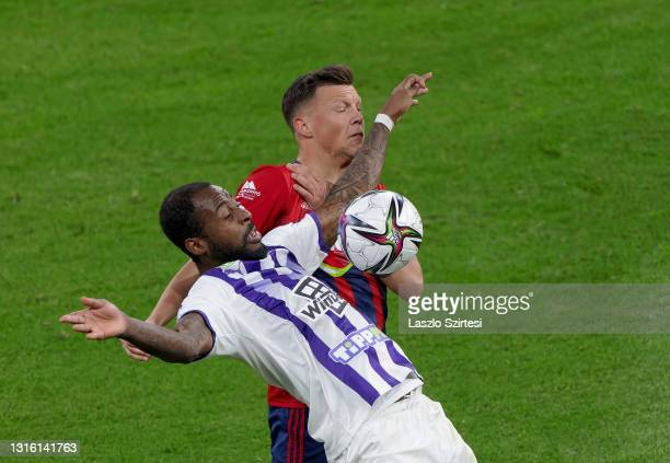 Junior Tallo of Ujpest FC fights for the ball with Adrian Rus of MOL Fehervar FC during the Hungarian Cup Final match between MOL Fehervar FC and...