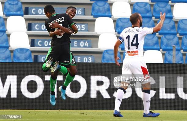 Junior Traore of US Sassuolo celebrates with his team-mate Rogeiro after scoring the opening goal during the Serie A match between US Sassuolo and...
