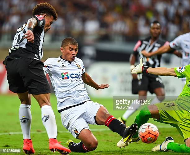 Junior Urso of Atletico MG and Minzum Quina of Melgar battle for the ball during a match between Atletico MG and Melgar as part of Copa Bridgestone...