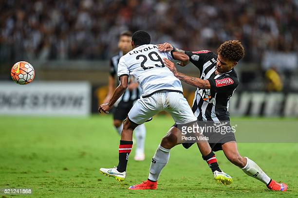 Junior Urso of Atletico MG and Nilson Loyola of Melgar battle for the ball during a match between Atletico MG and Melgar as part of Copa Bridgestone...
