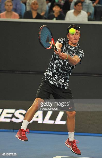 Junior US Open title holder Omar Jasika of Australia plays a return against Rafael Nadal of Spain during an exhibition match of Fast4 Tennis ahead of...
