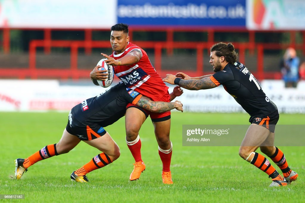 Junior Vaivai (C) of Hull KR has his progress blocked by Jamie Ellis (L) and Alex Foster (R) of Castleford Tigers during the Roger Millward Trophy match between Hull KR and Castleford Tigers as part of the Betfred Super League at KCOM Stadium on June 1, 2018 in Hull, England.