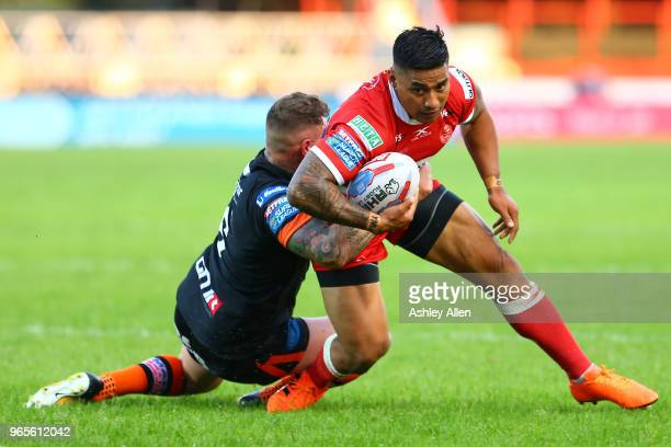Junior Vaivai of Hull KR is tackled by Jamie Ellis of Castleford Tigers during the Roger Millward Trophy match between Hull KR and Castleford Tigers...