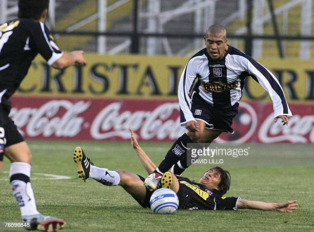 Junior Visa of the Alianza de Lima tries to get away from Jose Luis Cabion of Chilean Colo Colo at the Estadio Monumental of Santiago de Chile 08...