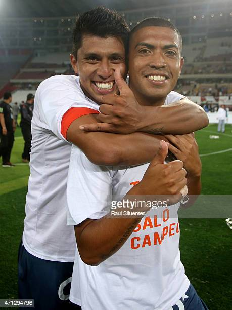 Junior Viza and Rinaldo Cruzado of Cesar Vallejo celebrate after winning a final match between Alianza Lima and Cesar Vallejo as part of Torneo del...