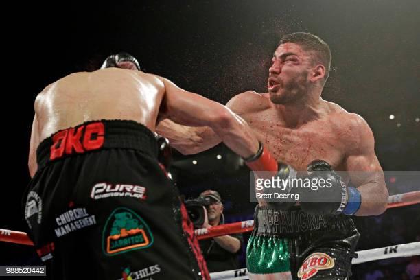Junior welterweight Alex Saucedo left lands an overhand right on Leonardo Zappavigna at Chesapeake Energy Arena on June 30 2018 in Oklahoma City...