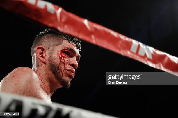 Junior welterweight Alex Saucedo looks out into the crowd as he heads to his corner during the fight against Leonardo Zappavigna at Chesapeake Energy...
